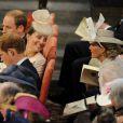 Kate Middleton, enceinte de plus de 7 mois, un peu dissipée avec Sophie de Wessex à l'abbaye de Wesminster, à Londres, le 4 juin 2013, pour un service spécial commémorant les 60 ans du couronnement de la reine Elizabeth II, assuré par l'archevêque de Canterbury Justin Welby et le doyen de Westminster John Hall.