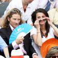 Gwendal Peizerat et une amie à Roland-Garros lors du 12e jour des Internationaux de France le 6 juin 2013