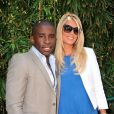 Rio Mavuba et son amie Elodie à Roland-Garros lors du 12e jour des Internationaux de France le 6 juin 2013