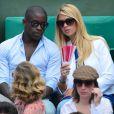 Rio Mavuba et sa compagne Elodie à Roland-Garros lors du 12e jour des Internationaux de France le 6 juin 2013