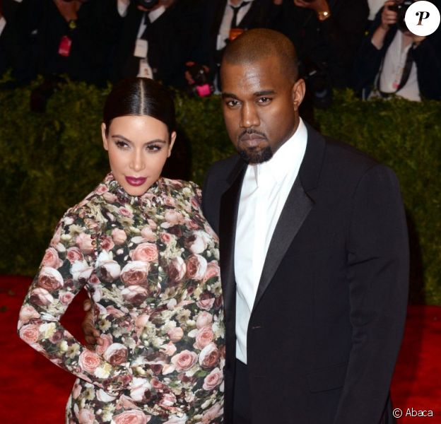 Kim Kardashian et Kanye West, tous deux en Givenchy par Riccardo Tisci lors du MET Gala à New York. Le 6 mai 2013.