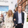 James Middleton et Donna Air quittant le Queen's Club après la finale du tournoi du Queen's (Aegon Tennis Championships) marquée par la victoire d'Andy Murray, le 16 juin 2013 à Londres.