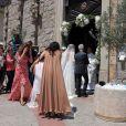 Le mariage religieux de Thomas Langmann et Céline Bosquet à Porto-Vecchio en Corse le 22 juin 2013 : La mariée entre en scène au bras de son père en l'église Saint-Jean-Baptiste