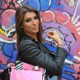 EXCLU - Laury Thilleman prend la pose avec son sac La Halle au Dôme à Paris, le jeudi 27 juin 2013