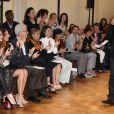 Zuhair Murad, applaudi à l'issue de son défilé haute couture à la Villa Montmorency. Paris, le 4 juillet 2013.