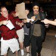 Lionel Richie et sa fille Sofia (15 ans) à l'aéroport de Los Angeles, le 15 juillet 2013.