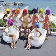 Les danseuses du Crazy Horse posent sur la Croisette le 19 Juillet 2013 à Cannes