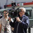 """Claude Lelouch au travail caméra à la main sur le dernier jour de tournage de son film """"Salaud, on t'aime"""" à Saint-Gervais-les-Bains, le 31 juillet 2013."""