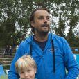 Henri Leconte & et son fils Ulysseà Knokke le 18 août 2013.