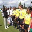 La ministre déléguée Yamina Benguigui avant le coup d'envoi de la finale du tournoi de football des VIIe Jeux de la francophonie, le 15 septembre 2013, à Nice.