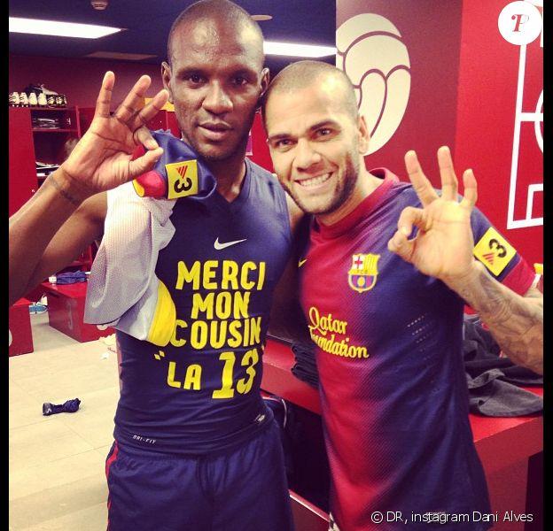 Dani Alves et Eric Abidal à Barcelone le 6 avril 2013.