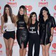 Kendall Jenner, Khloe kardashian, Kourtney kardashian and Kylie Jenner sur le tapis rouge du iHeartRadio Music Festival au MGM Grand Arena à Las Vegas, le 21 septembre 2013.
