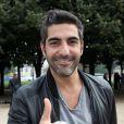 Ary Abittan - Tournoi de pétanque organisé place des Invalides à Paris et dont les fonds ont été reversés à l'association Meghanora, seule association en Europe à aider la recherche concernant les tumeurs rénales de l'enfant. Le 29 septembre 2013.