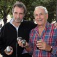 Jean-Jacques Bourdin et Patrice Laffont - Tournoi de pétanque organisé place des Invalides à Paris et dont les fonds ont été reversés à l'association Meghanora, seule association en Europe à aider la recherche concernant les tumeurs rénales de l'enfant. Le 29 septembre 2013.