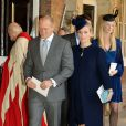 Zara Phillips-Tindall et son mari Mike Tindall quittant la chapelle royale après le baptême du prince George de Cambridge, 3 mois, le 23 octobre 2013 au palais Saint James, à Londres.