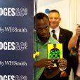 Usain Bolt chez Selfridge, pour une séance de dédicaces de son autobiographie Faster than Lightning à Londres, le 19 septembre 2013
