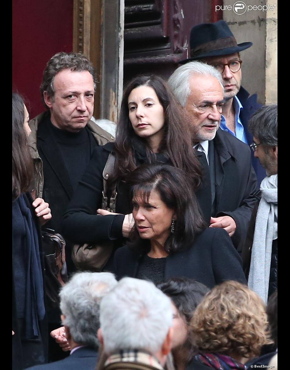 Marine et Dominique Strauss-Kahn, Anne Sinclair - Obsèques de Brigitte Guillemette, seconde épouse de Dominique Strauss-Kahn, en l'eglise Saint-Thomas-d'Aquin à Paris, le 7 novembre 2013.