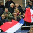 François Hollande lors de la victoire de l'équipe de France sur l'Ukraine (3-0) quilui offre la qualification au mondial 2014 au Brésil, le 19 novembre 2013 au Stade de France à Saint-Denis, entouré de Valérie Fourneyron, Thierry Rey et Claude Sérillon