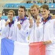 Amaury Leveaux, Fabien Gilot, Clément Lefert et Yannick Agnel après leur victoire sur le relais 4x100 m nage libre lors des JO de Londres le 31 juillet 2012