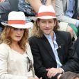 Gwendal Peizerat et sa compagne -  Internationaux de France de tennis de Roland Garros à Paris Le 30 mai 2014.