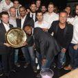 Les handballeurs de l'équipe de France avec Jean-Rochau restaurant la Gioia à Paris pour célébrer le titre de champion d'Europe de handball décroché face au Danemark, le 27 janvier 2014