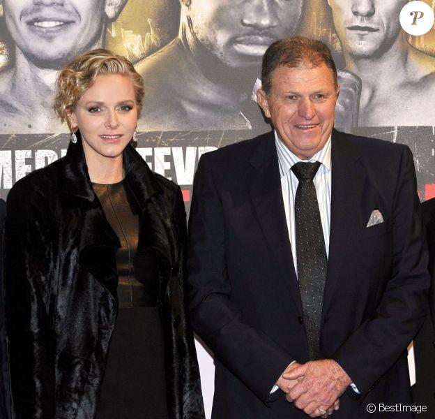 La princesse Charlene de Monaco a assisté au championnat du monde WBA des poids moyens entre Gennady Golovkin et Osumanu Adama au côté de son père Michael Wittstock dans la salle des Etoiles du Sporting de Monte-Carlo, à Monaco le 1er février 2014