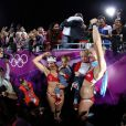 Misty May-Treanor et Kerri Walsh-Jennings, qui fêtent ici leur succès avec les deux enfants de Kerri, ont décroché le 8 août 2012 aux JO de Londres une troisième médaille d'or consécutive dans le tournoi olympique de beach-volley.