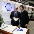 Kevin Rolland dans la boutique Baume & Mercier rue de la Paix à Paris où il a récupéré sa montre Clifton offerte par la Maison d'Horlogerie le 25 février 2014 remise par David El Hayani, le directeur France Baume & Mercier