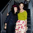 Katie Holmes et Jeanne Yang au défilé Michael Kors, à la fashion week de New York, le 11 septembre 2013.