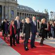 La princesse Victoria de Suède, qui avait dissimulé son attelle dans sa manche de pantalon, et son époux le prince Daniel à la sortie du Petit Palais après l'inauguration de l'exposition ''Carl Larsson, l'imagier de la Suède'', à Paris le 6 mars 2014.