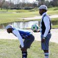 Sidney Govou et Sylvain Wiltord lors de la première Footgolf Cup 2014 au golf de Feucherolles en France le 5 mars 2014.