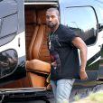 Kanye West, surpris à la descente d'un hélicoptère à Rio de Janeiro. Le 9 mars 2014.