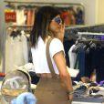 Kylie Jenner fait du shopping avec ses soeurs dans la boutique Intermix. Miami, le 12 mars 2014.