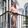 Kim Kardashian, sur le balcon de sa chambre à la Casa Casuarina (plus connue sous le nom de Villa Versace). Miami, le 12 mars 2014.