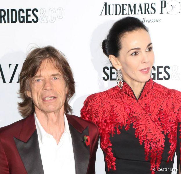 """Mick Jagger et L'Wren Scott à la soirée """"Harper's Bazaar Women of the Year Awards"""" au Claridge's Hotel à Londres, le 5 novembre 2013."""