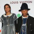 """Pharrell Williams et sa femme Helen Lasichanh au  35ème """"Moca Gala"""" à Los Angeles, le 29 mars 2014."""