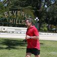 Nicolas Sarkozy fait du jogging dans les rues de Beverly Hills sous un soleil de plomb le 28 avril 2014.