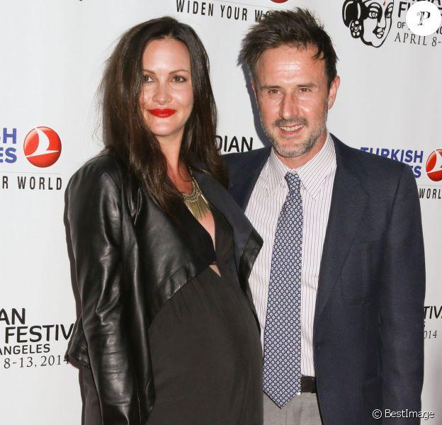 David Arquette et sa petite amie Christina McLarty (enceinte) à Hollywood, le 8 avril 2014.