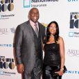 Magic Johnson et son épouse Cookie Johnson lors du gala Ebony Power 100 au Frederick P. Rose Hall, Jazz au Lincoln Center de New York le 4 novembre 2013