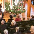 La princesse Märtha-Louise, son époux Ari Behn et leurs filles les princesses Maud, Leah et Emma au premier rang avec le couple royal lors de la messe de Noël à Oslo, le 25 décembre 2013 à l'église d'Holmenkollen