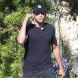 Mila Kunis enceinte et son fiancé Ashton Kutcher à Los Angeles, le 12 mai 2014.