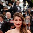 Laetitia Casta, sublime égérie L'Oréal Paris, arrive à la projection du film Grace de Monaco à Cannes le 14 mai 2014