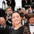 Gong Li tout de noir vêtue, arrive à la cérémonie d'ouverture du Festival de Cannes. Le 14 mai 2014