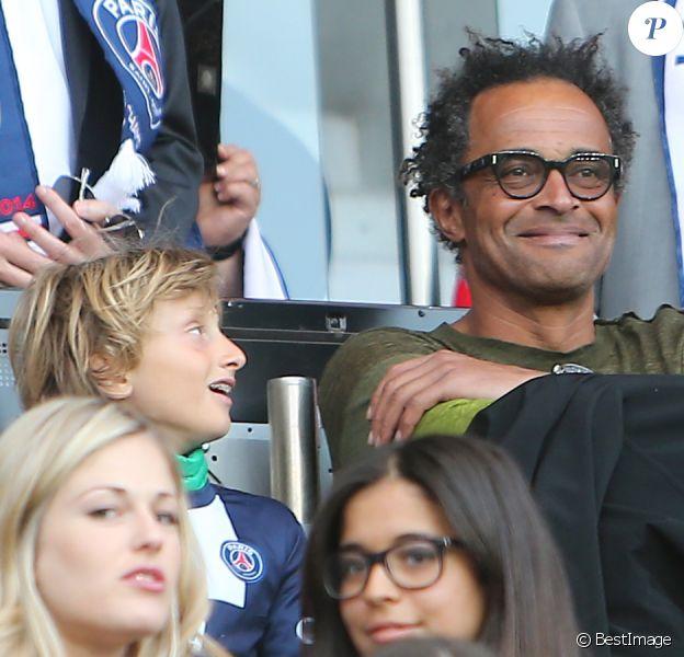 Yannick Noah et son fils Joalukas assistent au match Psg-Montpellier au Parc des Princes à Paris, le 17 mai 201417/05/2014 - Paris