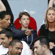 Smaïn, sa compagne Sid et son fils Rayanne lors du match Psg-Montpellier au Parc des Princes à Paris, le 17 mai 2014