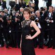 """Anais Demoustier à la montée des marches du film """"Deux jours, une nuit"""" lors du 67 ème Festival du film de Cannes le 20 mai 2014."""