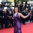 """Aida Touihri à la montée des marches du film """"Deux jours, une nuit"""" lors du 67 ème Festival du film de Cannes le 20 mai 2014."""
