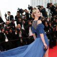 """Sarah Marshall (Robe Jitrois, boots Giuzeppe Zanotti et boucles d'oreilles Montblanc) - Montée des marches du film """"The Search"""" lors du 67e Festival du film de Cannes le 21 mai 2014"""