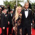 """Tatiana Laurens Delarue et son mari Xavier Delarue - Montée des marches du film """"The Search"""" lors du 67e Festival du film de Cannes le 21 mai 2014"""