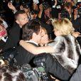 Sharon Stone, John Travolta et Kelly Preston pour une instant de complicité au milieu des photographes à la soirée Roberto Cavalli sur son yacht sur le port de Cannes lors du 67e Festival de Cannes le 21 mai 2014.